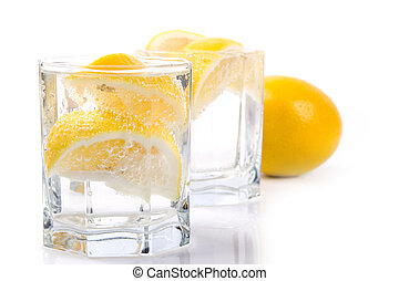 soda water and lemon - two glasses with soda water and lemon...