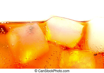Soda with ice cubes bubbles macro close up background...