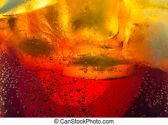Soda with ice cubes bubbles macro close up background