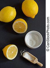 Sodium bicarbonate and lemon on black background