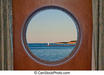 Sodus Bay Lighthouse on Lake Ontario seen through a Boat Porthole