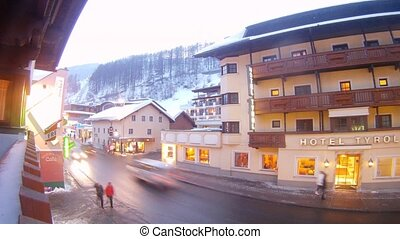 Hotel Tyrol stands near road and shop in evening - SOELDEN -...
