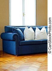 sofá azul, ángulo