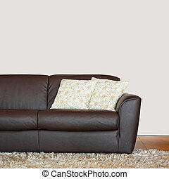 Brown leather sofa with pillows