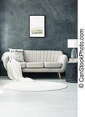 Sofa by dark grey wall