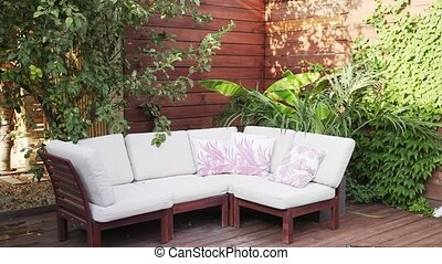 Sofa in the yard of the house. Furniture outside. Luxury villa, no people.