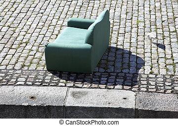Sofa on cobblestone