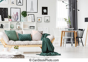 Sofa with cushions and blanket
