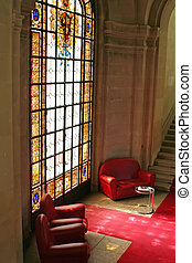 Sofas stained glass - Sofas in waiting area with stained...