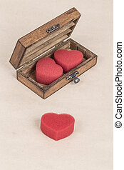 red hearts in a wooden box
