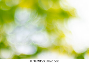 Soft blurred sweet green glitter bokeh nature abstract background
