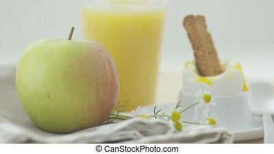 Soft-boiled egg for breakfast - Close-up shot of soft-boiled...