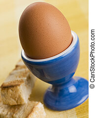 Soft Boiled Egg in a Egg Cup with Toasted Soldiers