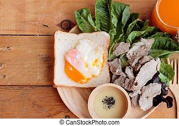 soft-boiled egg on toast with sliced pork tenderloin.
