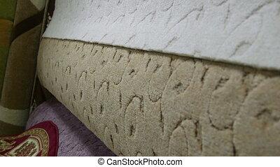 Soft carpet flooring variety in showroom of store tilt shot