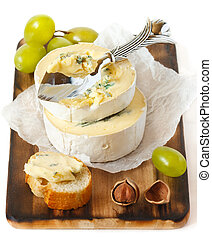 Soft cheese. - Delicious soft cheese, nuts and grape on an ...