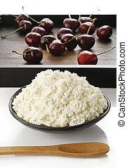 soft cheese with fresh ripe cherries