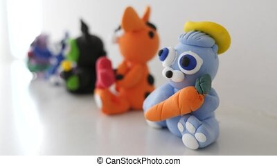 Soft clay dolls on a Shelf shot clip