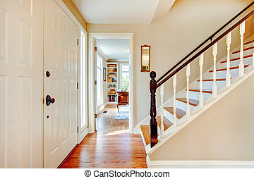 Soft colors hallway with stairs - Bright hallway with wooden...