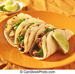 soft corn tacos with chicken and cilantro