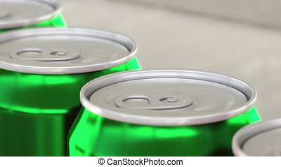 Soft drink or beer production line. Green aluminum cans on...