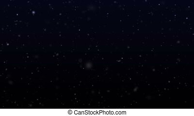 Soft falling snow on a dark background. Winter storm footage with snowflakes.