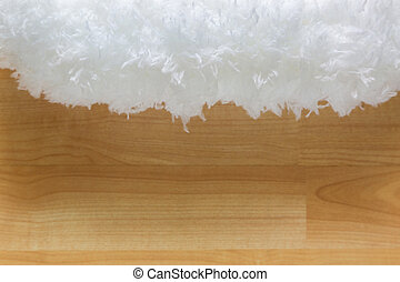Soft fluffy white cloud like fur microfiber fabric on blurred wooden background