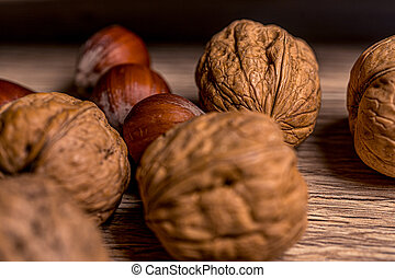 Soft focus. Hazelnuts and walnuts. Healthy vegetarian food. Natural background.Realistic closeup macro.