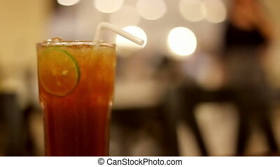 Soft focused Iced tea with lime slice and restaurant background