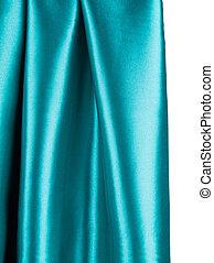 Soft folds of deep blue silk cloth texture.