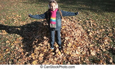Soft landing - Girl falling into the heap of autumn leaves...