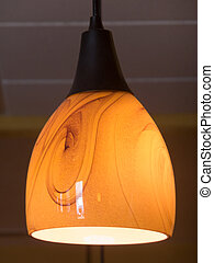 Soft Lighting - Hanging globed lamp fixture with orangish...