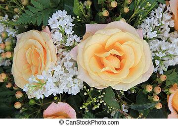 Soft orange rose and syringa in flower arrangement