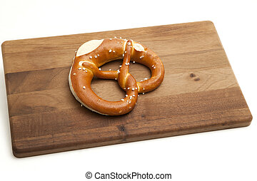 Soft pretzel on white with platter