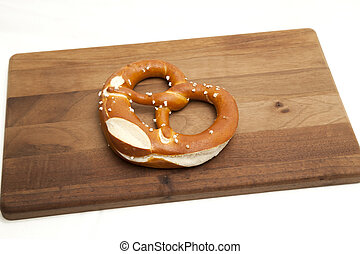 Soft pretzel on white with platter