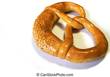 soft pretzel with sesame seeds - Close up view of a soft...