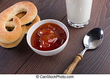 Soft pretzels, apricot jam and glass of milk