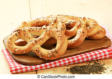Soft pretzels with caraway seeds on top