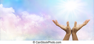 Healer's hands outstretched to sunburst with soft multi colored clouds