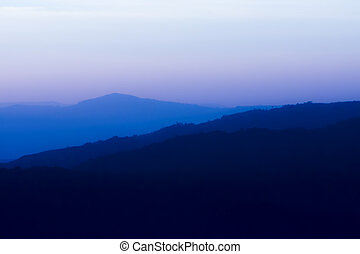 Soft silhouette of mountain with empty sky.