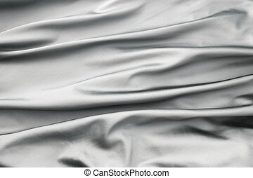 Soft velvet piece of silver fabric with folds to be used as background or overlay