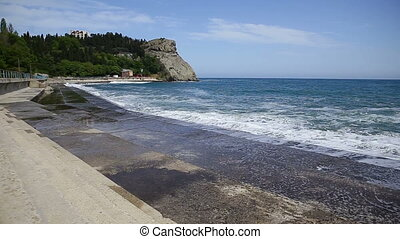 Soft wave of Black sea near Plaka cape. Partenit, Crimea.