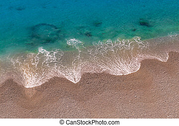 Soft wave of sea on the sand