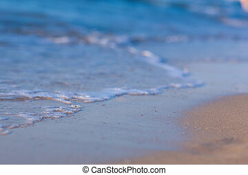 Soft wave of the sea on a sandy beach