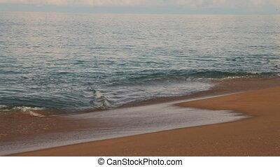 Soft wave of the sea on sandy beach. Blue sky and azure sea. Phuket island, Thailand.
