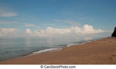 Soft wave of the sea on sandy beach. Blue sky and azure sea....