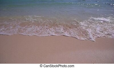 Soft wave of the sea on the sandy beach of Thailand