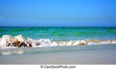 Soft wave of the sea on the sandy beach.