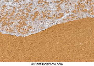 soft wave on a sandy beach