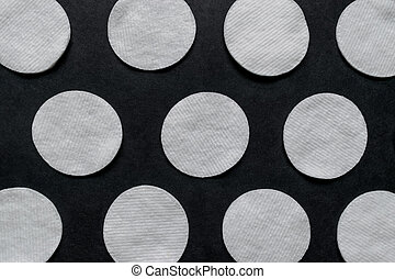 Soft, White and Round Pads on Black Background Surface